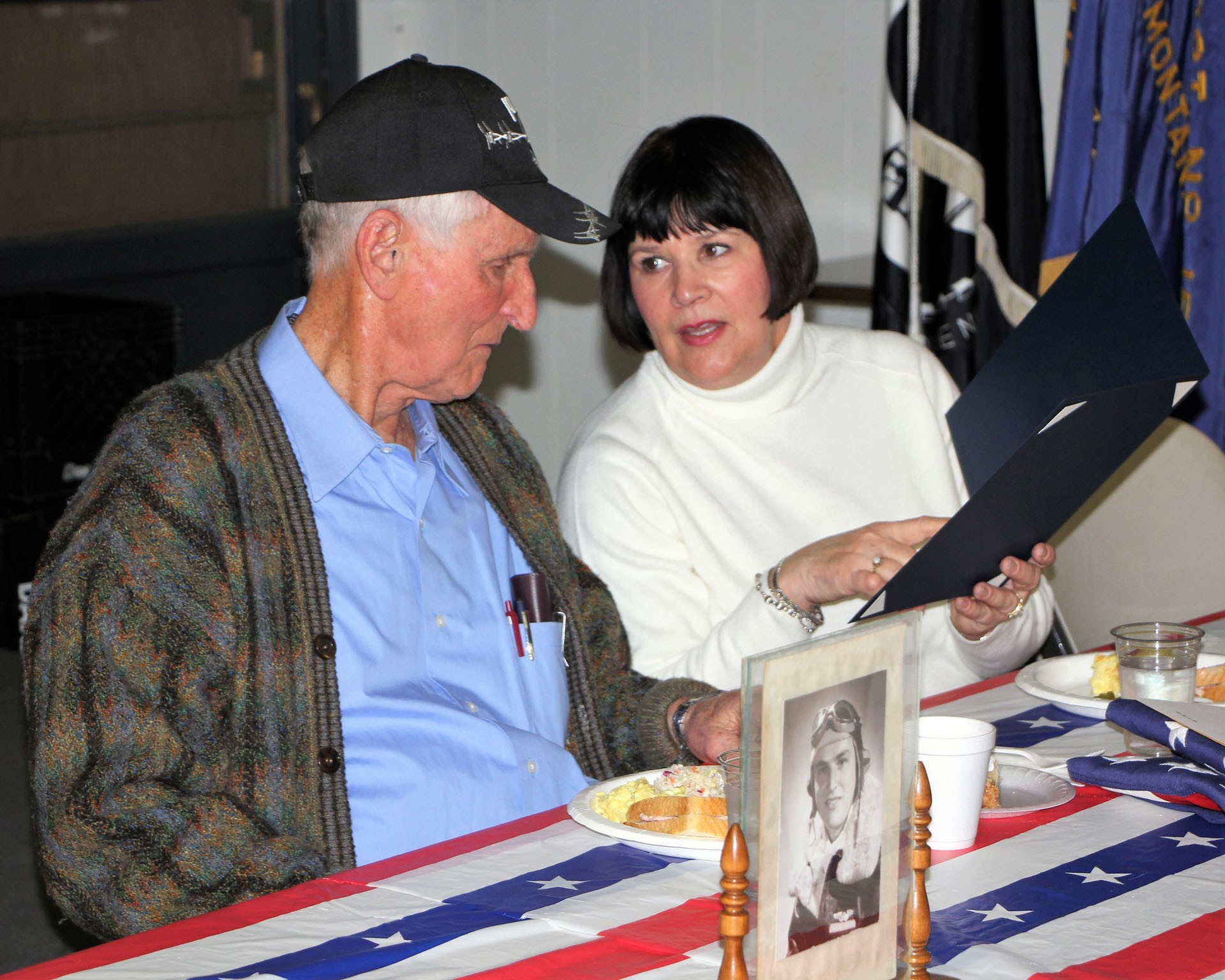 Frank Stoltz and his daughter Melissa Hartman look at the Montana Congressional Veteran Commendation award.STAR PHOTO/Sharon Moore
