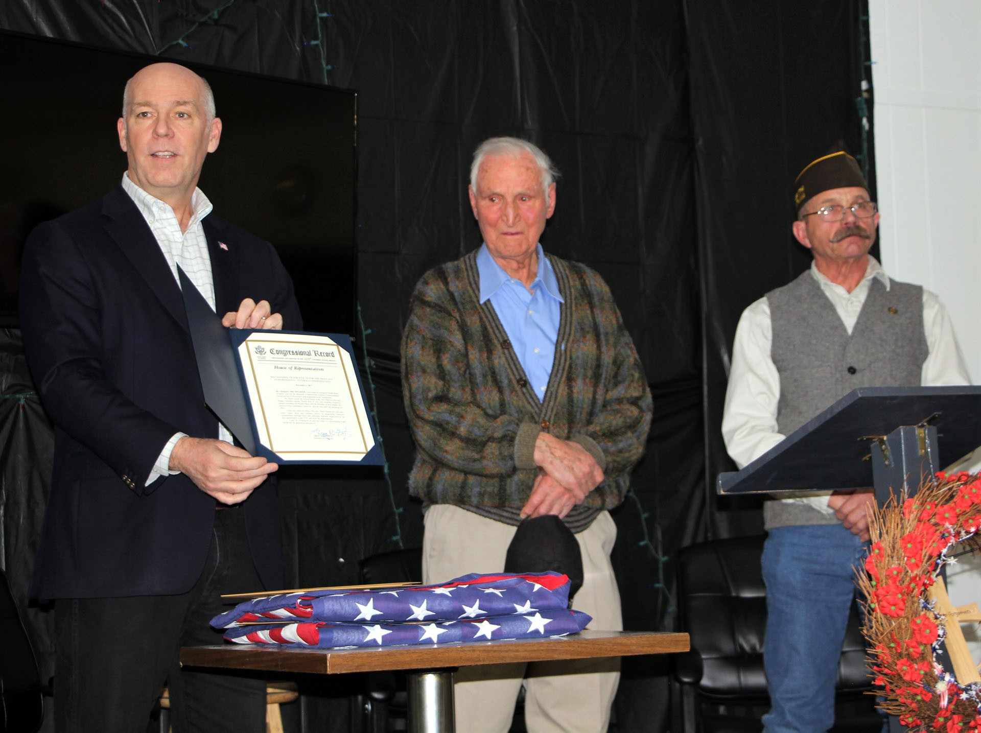 U.S. Congressman Greg Gianforte, Frank Stoltz, and Jack Bradley listen as Gianforte reads from the Congressional Record being awarded to Stoltz.STAR PHOTO/Sharon Moore