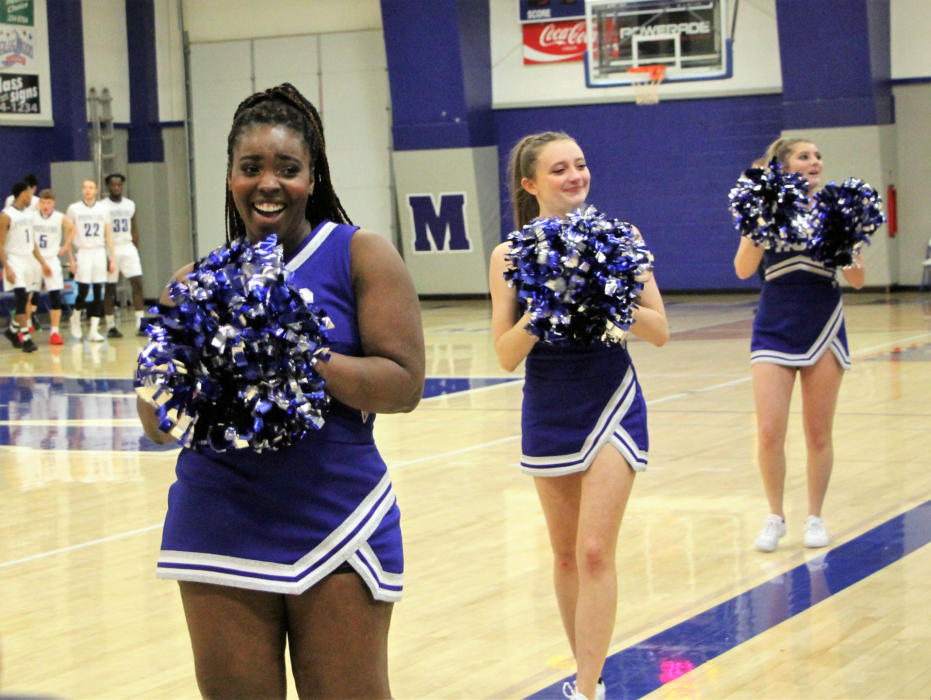MCC cheerleaders Loundia Whicker, Shyla Greer, and Ashley Becker cheer on the Pioneers.STAR PHOTO/Sharon Moore