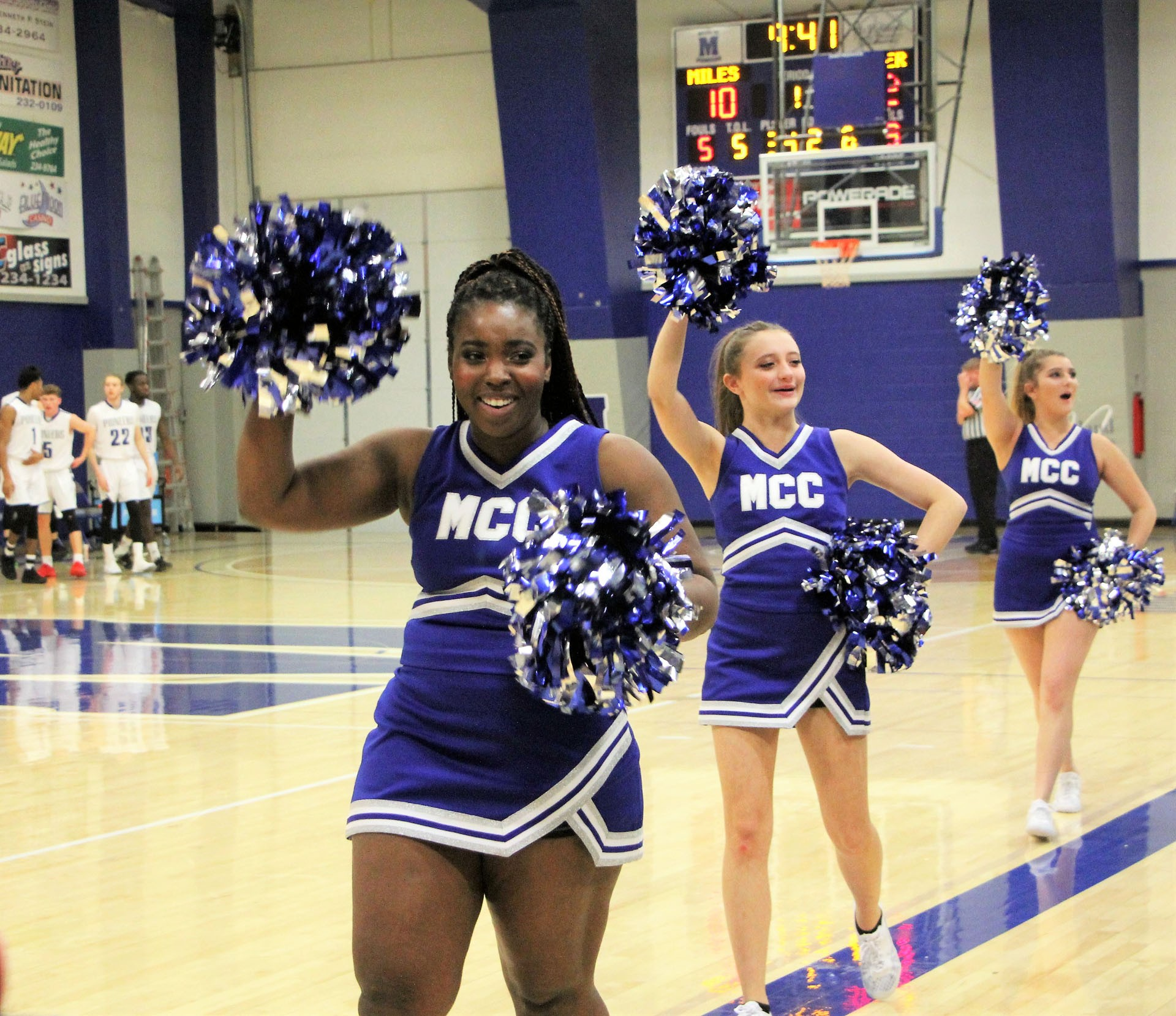 MCC cheerleaders Loundia Whicker, Shyla Greer, and Ashley Becker cheer on the Pioneers during their game against the Casper College Thunderbirds. While the MCC cheerleading team is small they pack a lot of heart into each cheer.STAR PHOTO/Sharon Moore