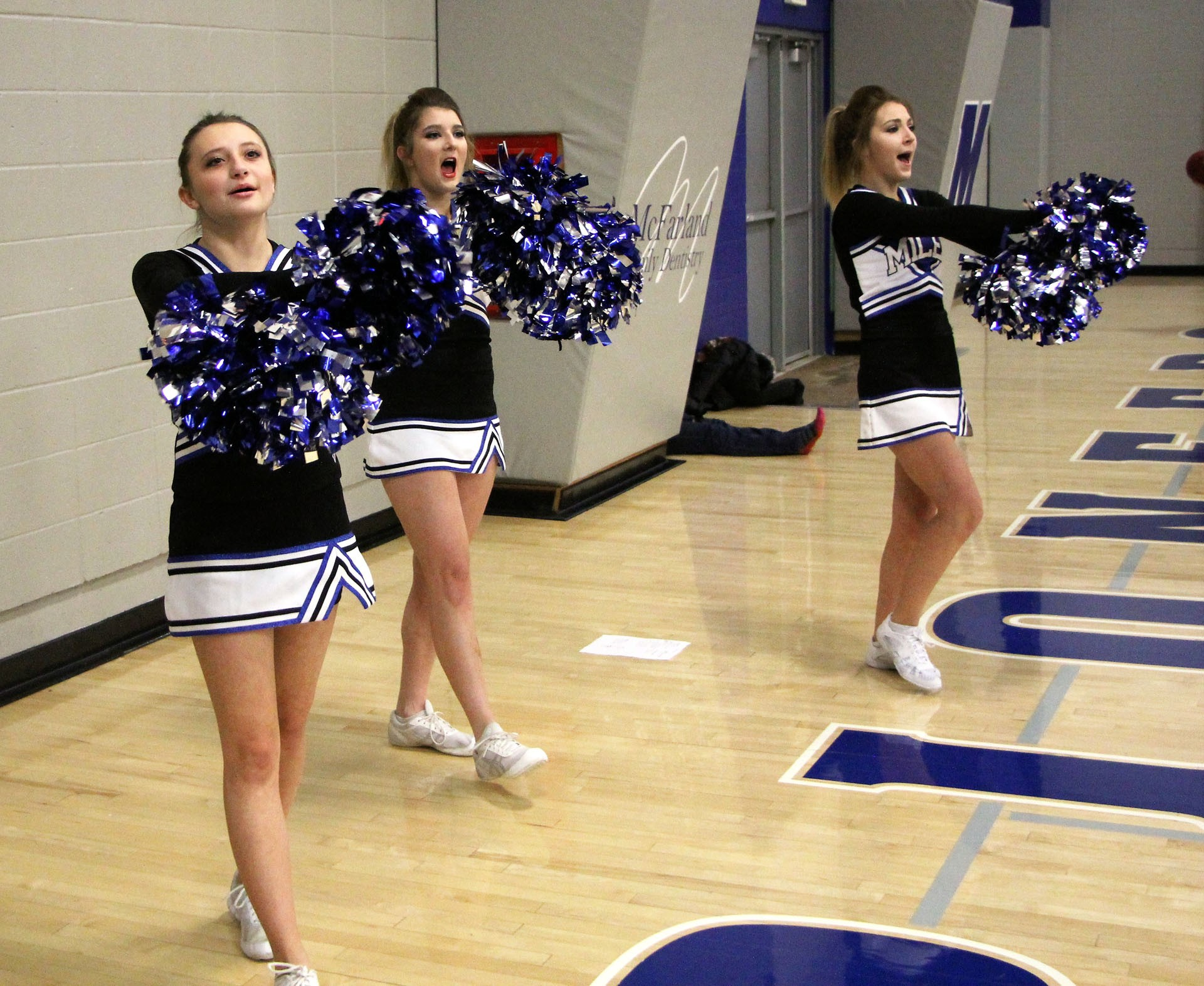 Shyla Greer, Ashley Becker, and Mariah Amsbury energize the crowd during a Pioneer game in January.STAR PHOTO/Sharon Moore