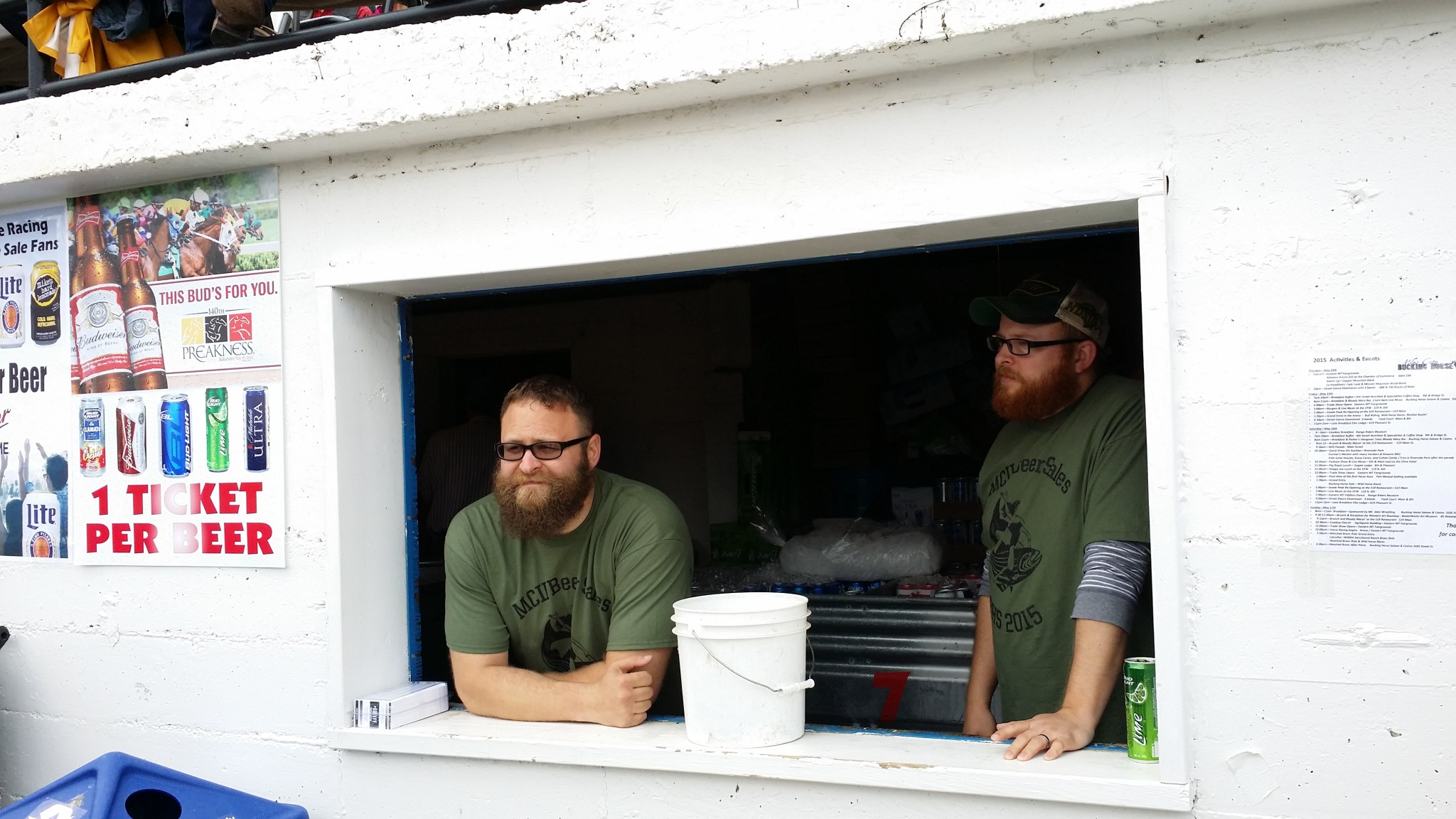 Dan Rice, left, and Brandon Janshen sell beer and snacks at the concessions stand underneath the grand stands at the fairgrounds during the Bucking Horse Sale rodeo.SUBMITTED PHOTO