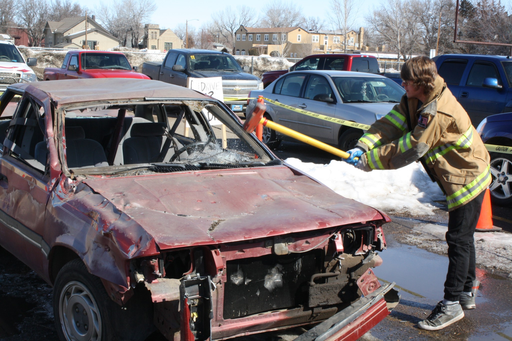 <strong>David Richter, a senior at CCDHS, spent a few minutes putting more than a few dents in the sedan stationed near the front of the high school's student parking lot. During their lunch break on Wednesday afternoon anyone who wanted to could take a swing at the car with a sledgehammer under the careful supervision of Miles City Fire and Rescue firefighters and EMTs. </strong>