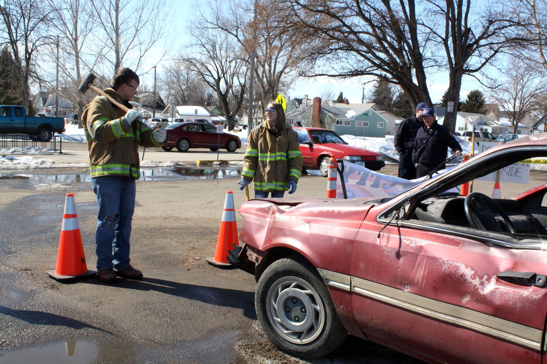 <strong>Tyson Hancock and  Kaitiey Penrod, right, both juniors get ready to put a few dents in the Ford Tempo. Though there weren't many students at the beginning of lunch, the car and spectacle would draw a sizable crowd as students began to return from getting food.</strong>