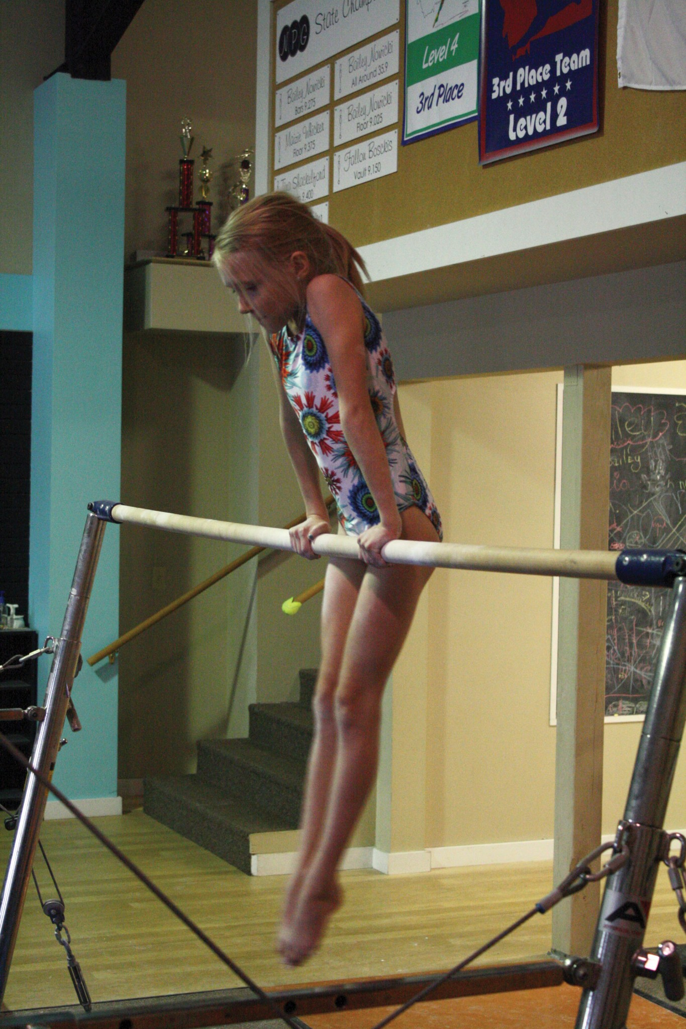 <strong>Gwendolyn Garvin practices the first part of her uneven bars routine during the regular team practice at Northern Pacific. The uneven bars is Garvin's favorite event, especially the dismount.</strong>