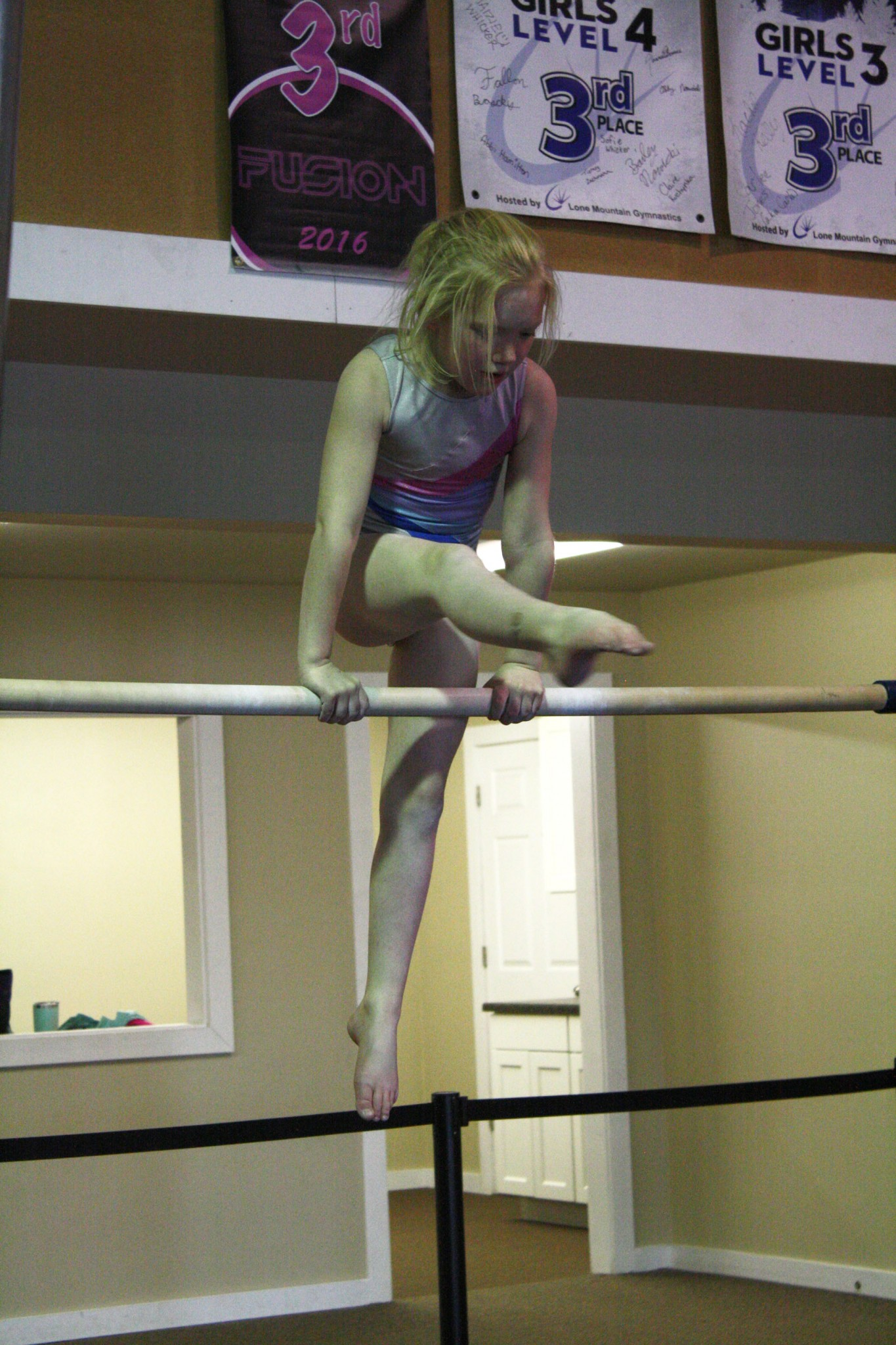 <strong> Allie Shepherd practices part of her uneven bars routine during practice on Thursday night. She is one of two girls who took home a gold medal, and the title of State Champion, during the 2018 Montana State Gymnastics Championship meet.</strong>