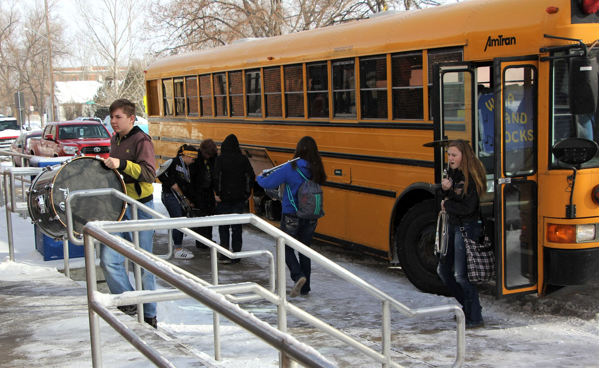 High school tournaments wouldn't be the same without bands. Here, the students in the Wibaux band are unloading and carrying their instruments in the CCDHS gymnasium.STAR PHOTO/Sharon Moore