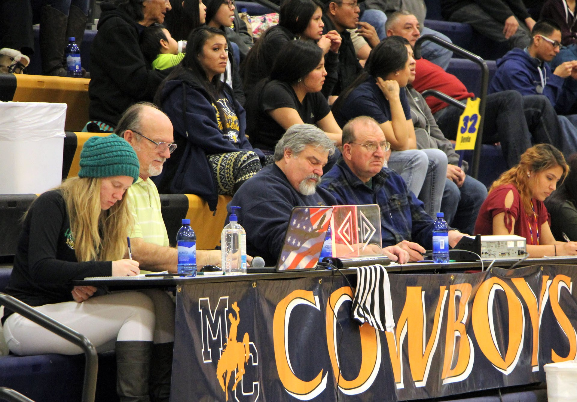 The scorer's table at the Montana Class 4C basketball tournament in Miles City has several volunteers workers, from students doing the scoring for their teams to adults doing the public address announcing, official scorebook and clock management. From left are Brooke Burley, Broadus; Darrell Neese, announcer from Miles City; John Laney, Executive Director of the Miles City Area Chamber of Commerce (official scorer); Doug Mangen of Miles City (clock), and Jean-Al Shorty, Northern Cheyenne.STAR PHOTO/Sharon Moore