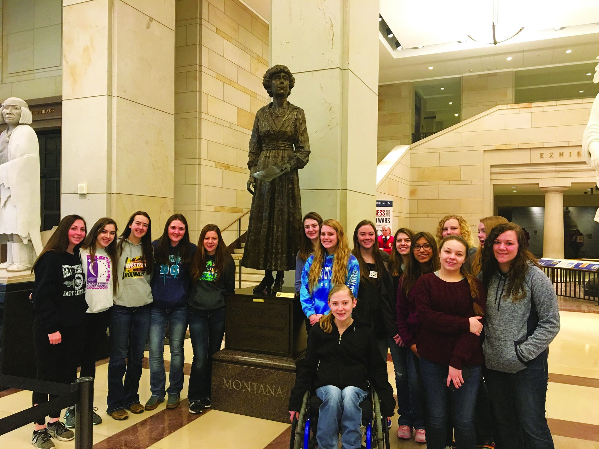 Some of the CCDHS students pose with a statue of Jeannette Rankin. Rankin was a politician and women's rights advocate from Montana. She was the first woman to hold federal office in the United States.