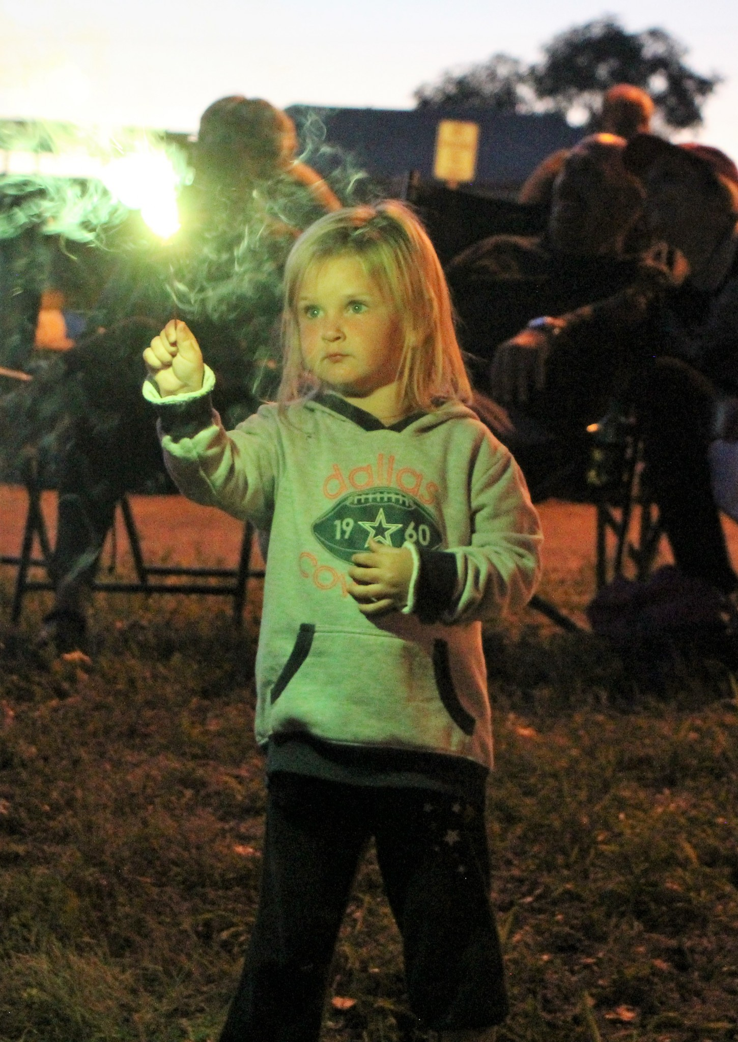 <strong>STAR PHOTO/Sharon Moore</strong><strong>Taylen Reid, 3, from Rigby, Idaho was visiting Miles City with her family for the CABA baseball tournament. She and her two sisters were enjoying sparklers by the Natural Oasis.</strong>