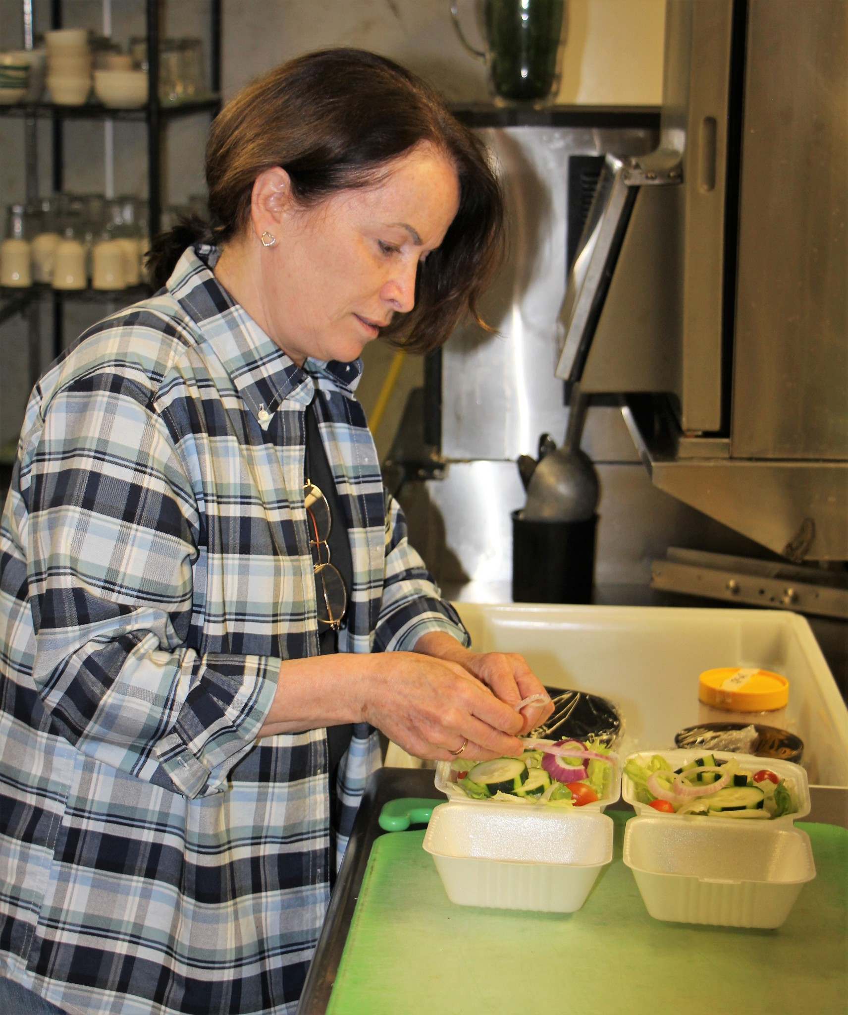 STAR PHOTO/Sharon Moore<strong>Sharon Humphrey, owner, assists with preparing salads for a to go order.</strong>