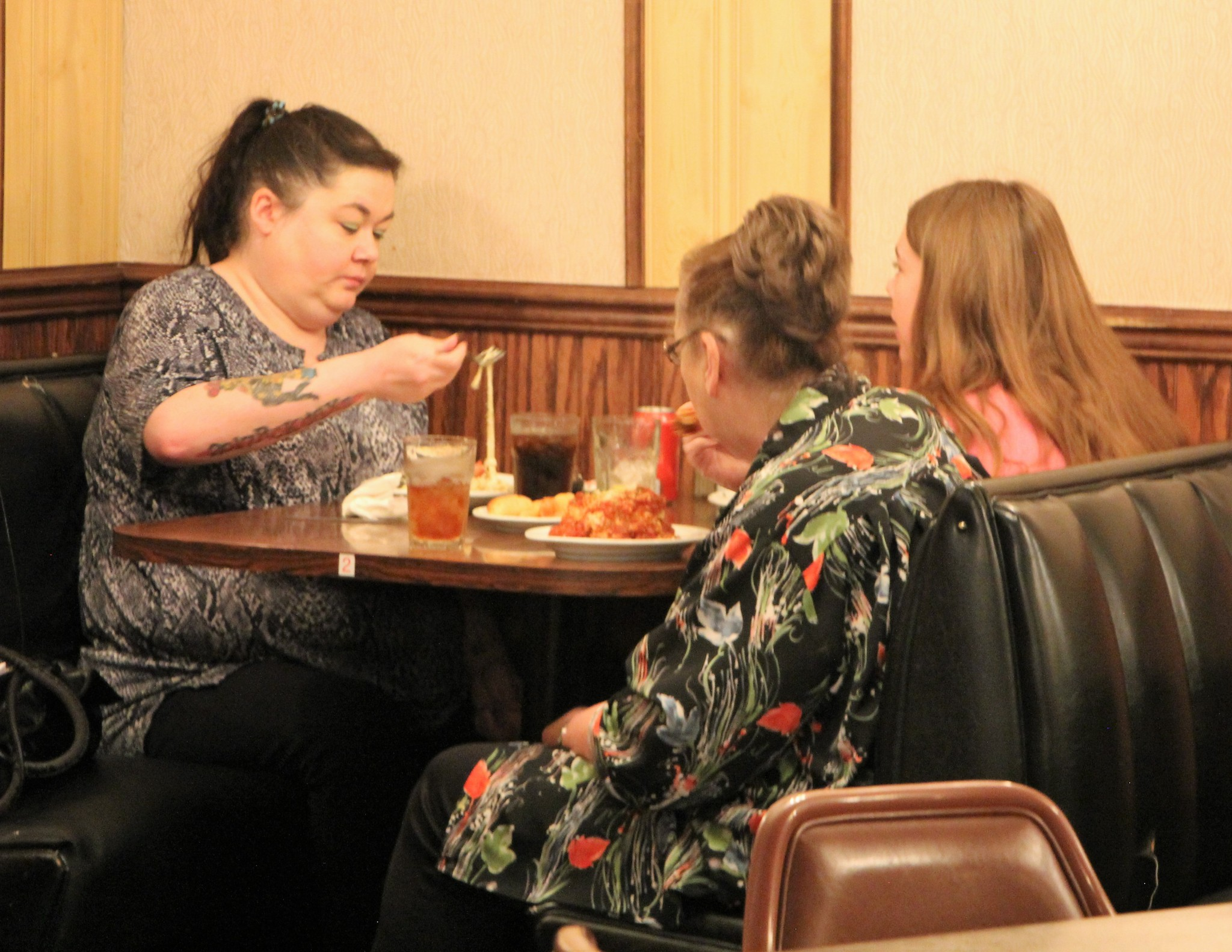 STAR PHOTO/Sharon Moore<strong>Maggi Allison, on right side in front, Karla Allison, back is Ruby Kuester, all of Miles City, enjoy a meal at the new Italian restaurant, Twin Does.</strong>